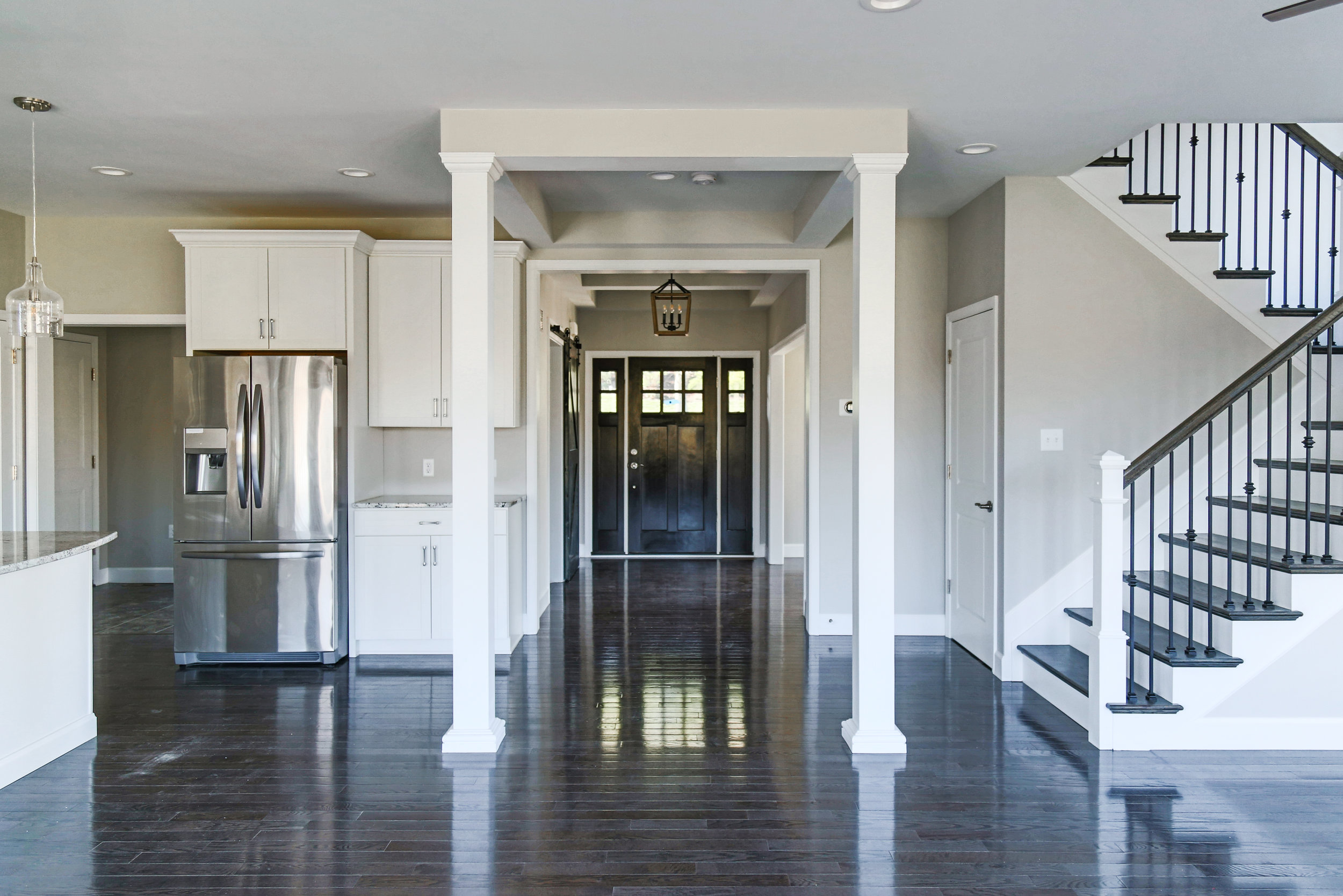 Coffered ceiling hallway leads you into the heart of the home