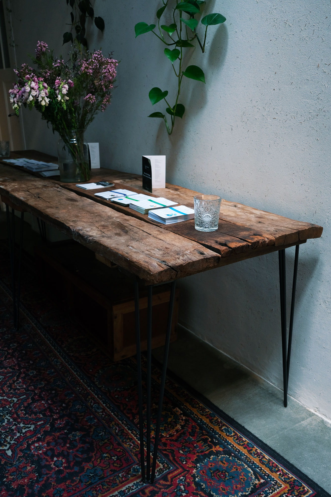 Antique Table - Did you know that all of the tables at The Conscious Club are self-made from antique and upcycled wood? We made the tables in The Green Temple from 300 year old oak floor boards from the famous Wester Tower. This is the same oak from the 1700's, where they made all of the V.O.C. ships from and you can still see this wood back in the ceilings of old Dutch churches like the Oudekerk. The wood from our flyer table in the hall comes from an old farm and we've transformed old army lockers into tables for our café area.