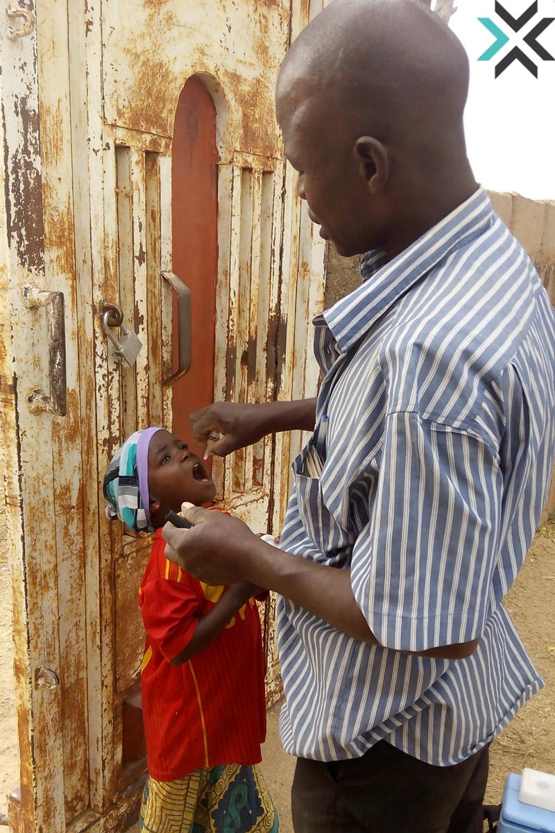 A Child Receiving Polio Medication in Uba City