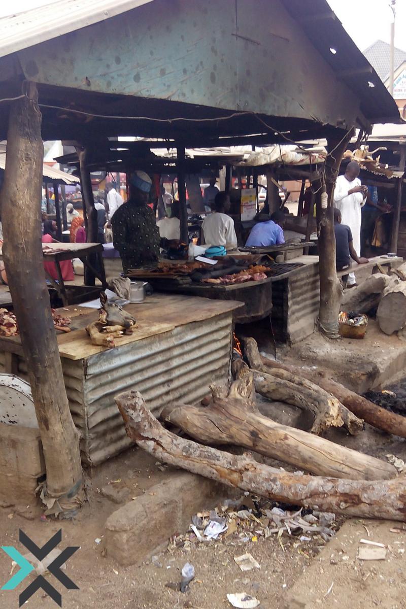 A Vendor Selling Suya, A Spicy Shish Kabob, in Uba City