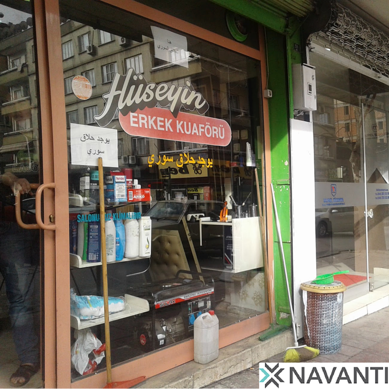 An Arabic sign advertises the services of a Syrian barberin a Turkish hair salon in Gaziantep, Turkey, Source: Navanti