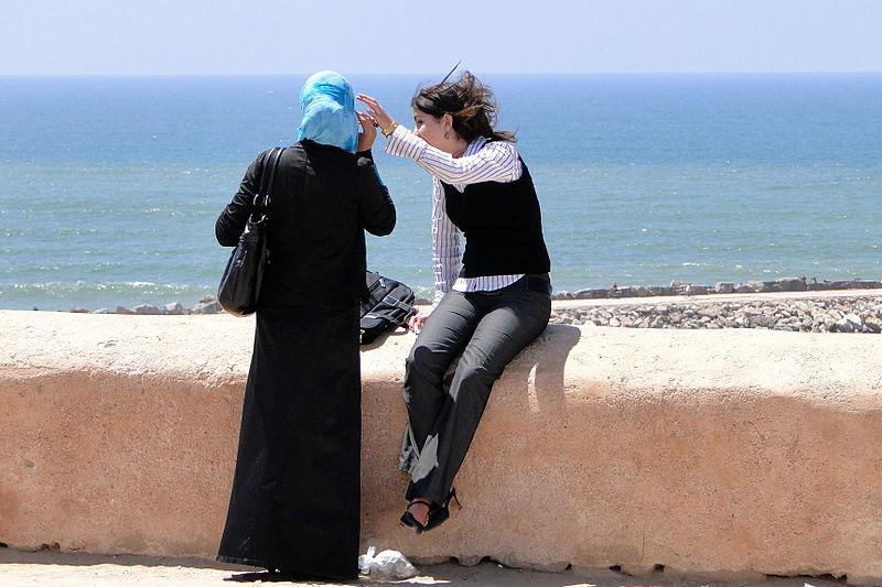 Women along the Kasbah ramparts. Source: Wikimedia Commons