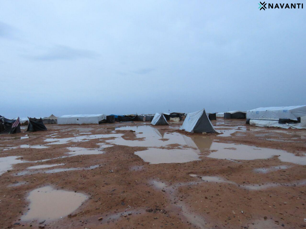 Stagnant water surrounds camp residences. Source: Navanti