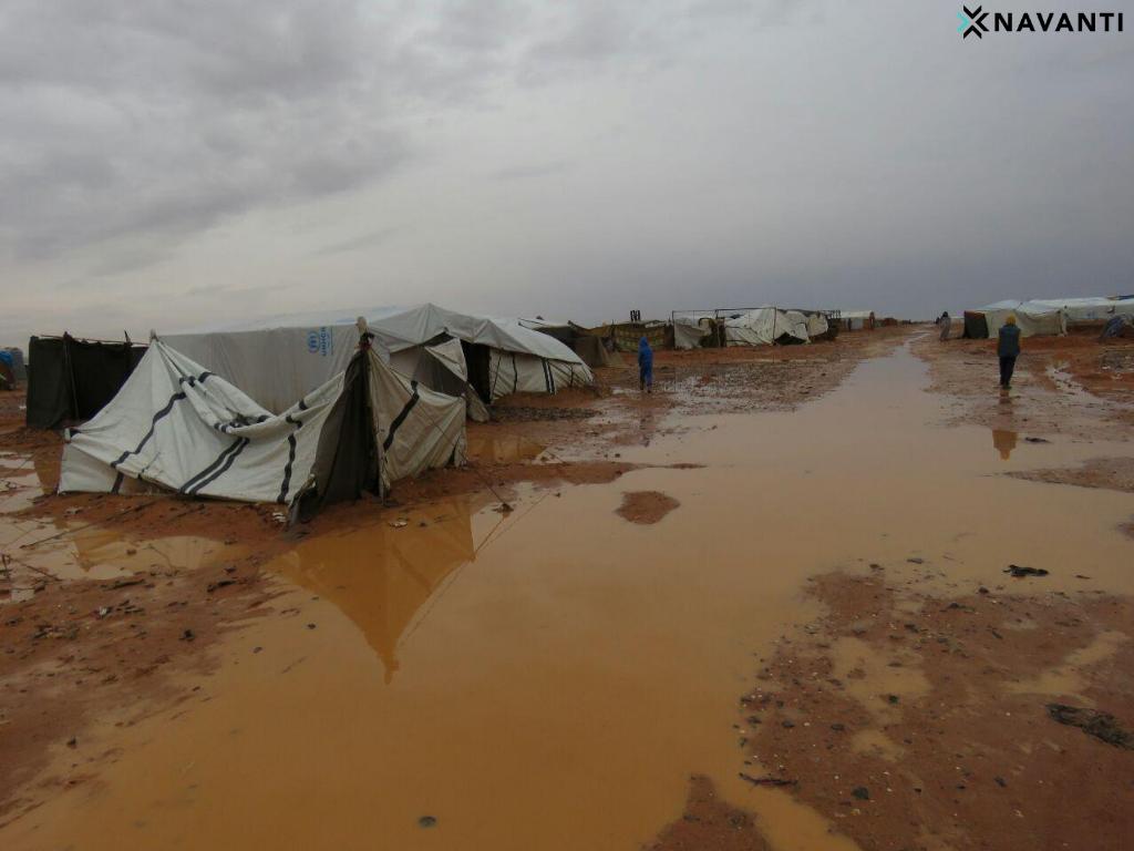 Dirt paths between tents turn into shallow streams when it rains. Source: Navanti