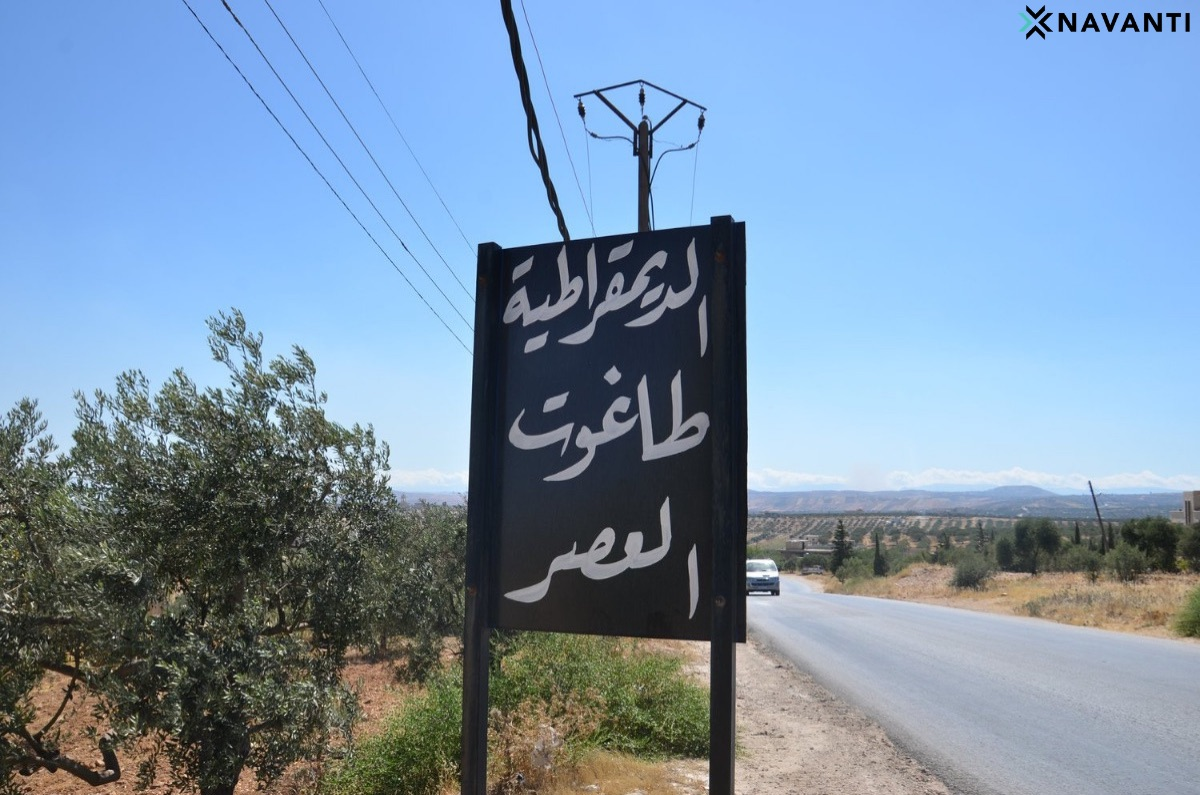 """A sign in Idlib reads, """"Democracy is the Tyrant of the Age."""" Source: Navanti"""