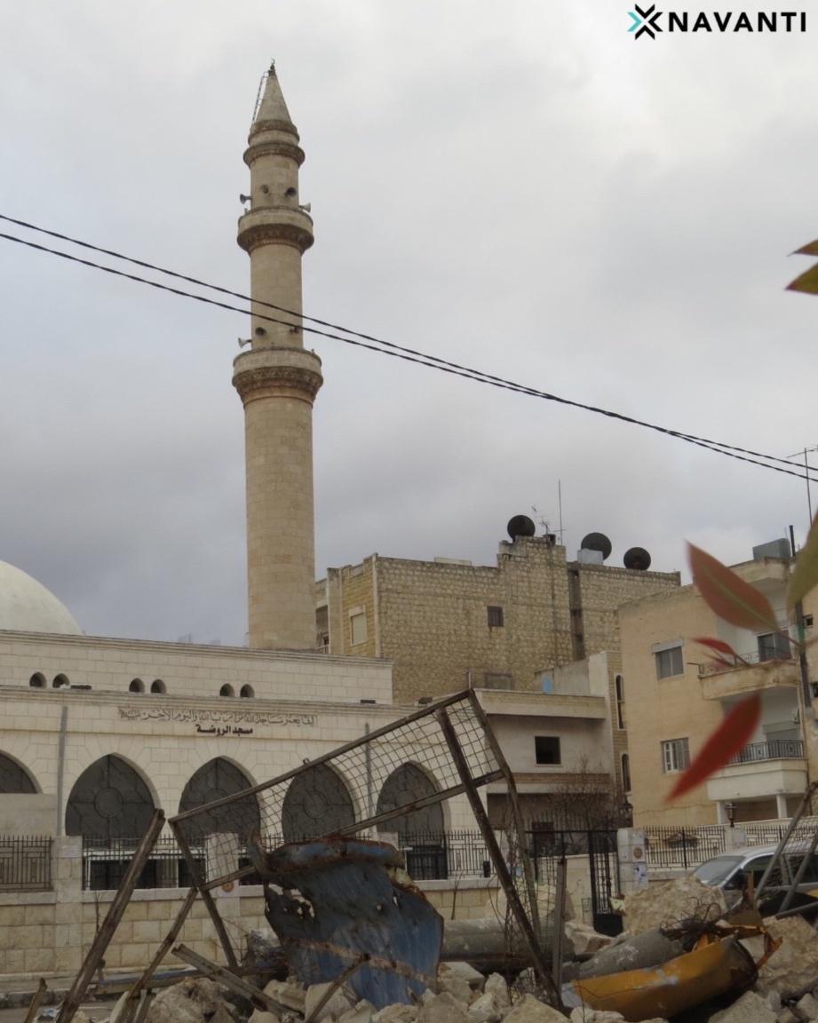 A minaret is visible behind rubble in Idlib City. Source: Navanti