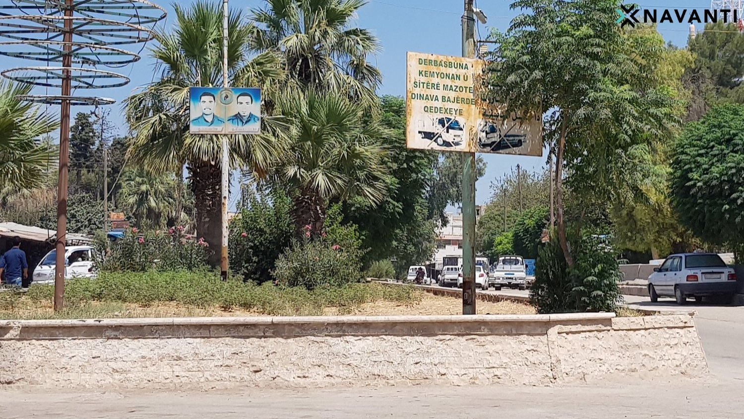 A sign forbidding trucks from entering Ras al-Ayn is juxtaposed with a sign commemorating fallen SDF soldiers. Source: Navanti