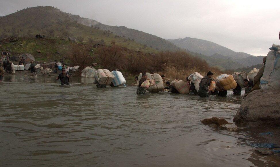 Kolbers cross a stream. Source: Kurdistan Human Rights Network