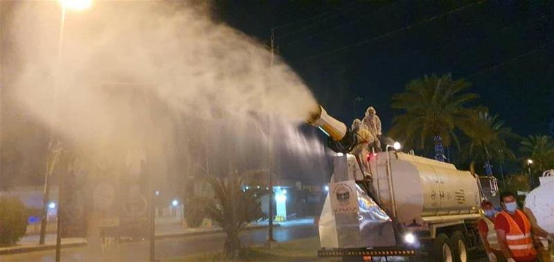 Baghdad Municipal Department workers sanitize a street in Jadriyah, Baghdad. Photo credit: Salam Khaleel.