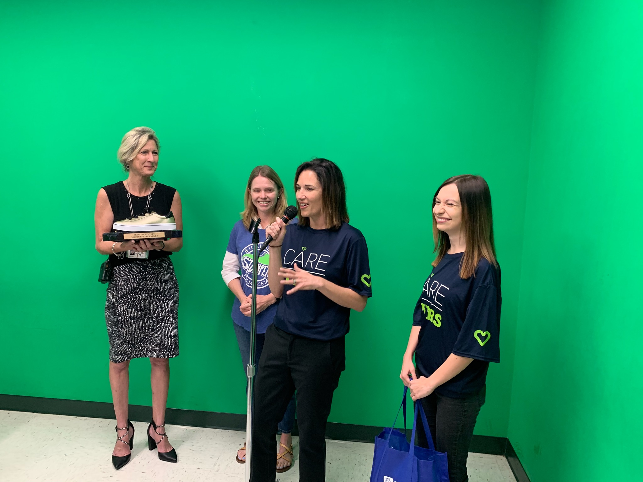 Principal Zilbar, Sidewalk Stompers president Emily Hinsdale, and AdventHealth Tampa's Jen Bradley and Roxanne Carlucci announcing their partnership on the Pride morning show in March.