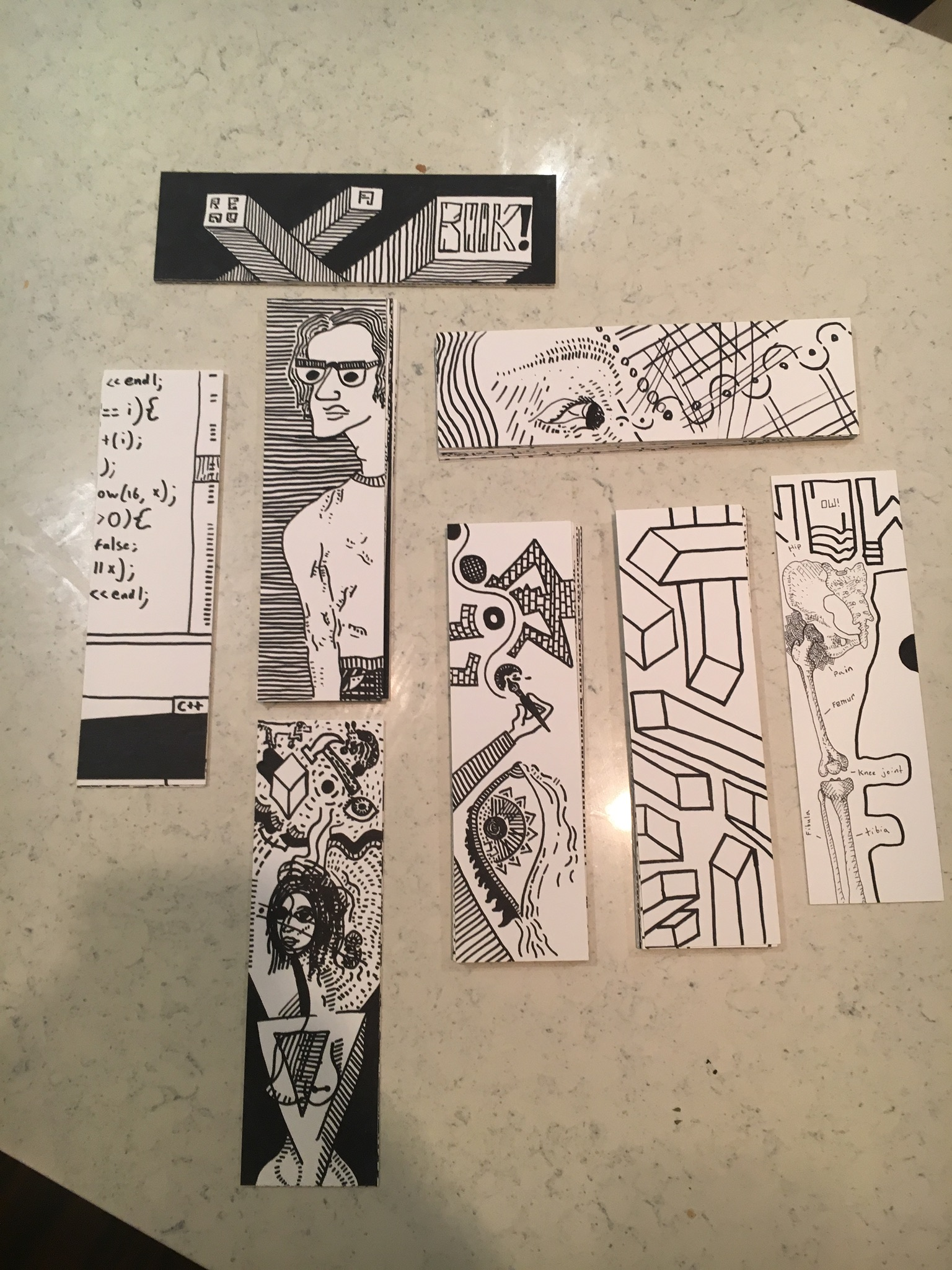 Stacks of bookmarks drawn by Alex Rusnak