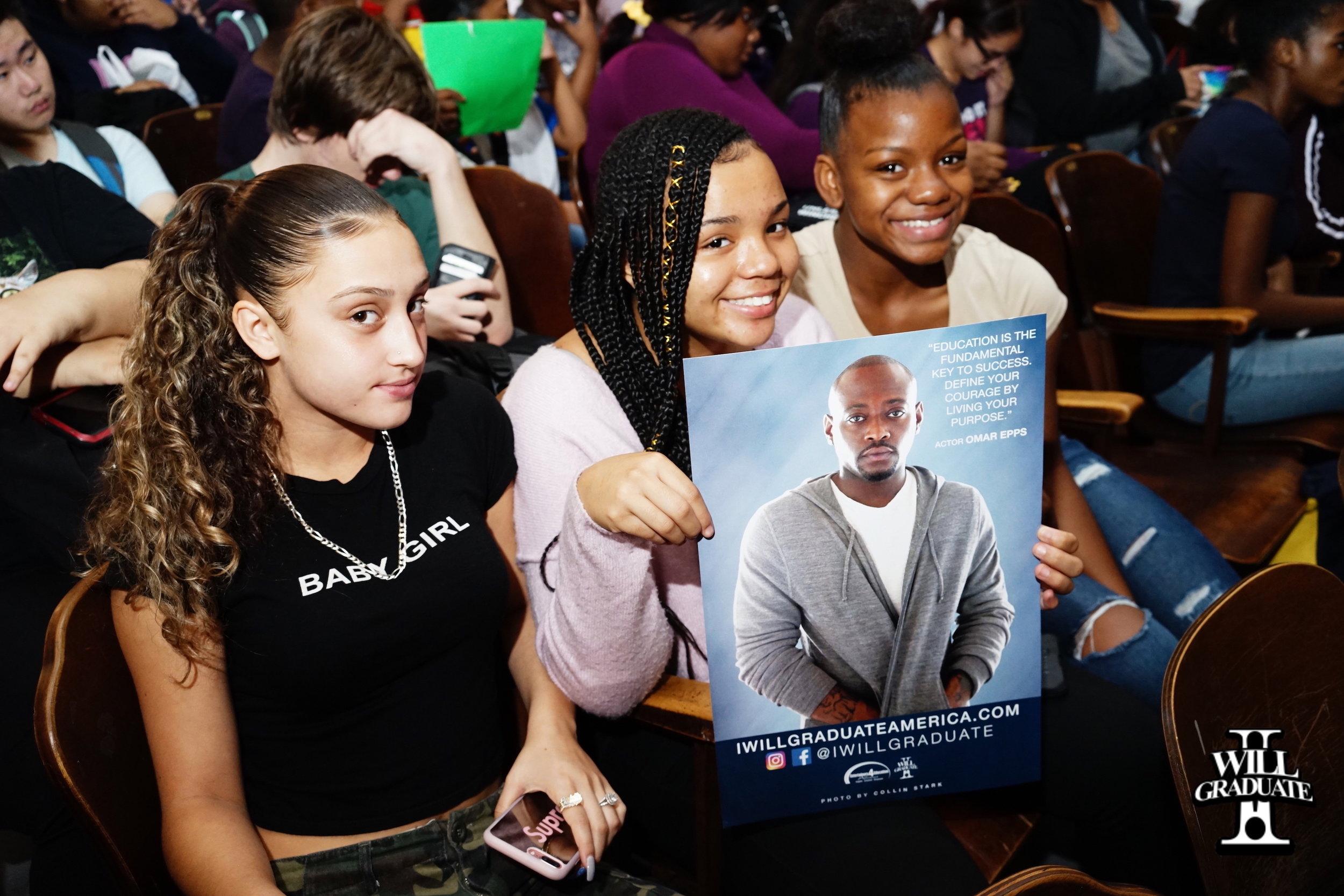 students holding photo.jpg