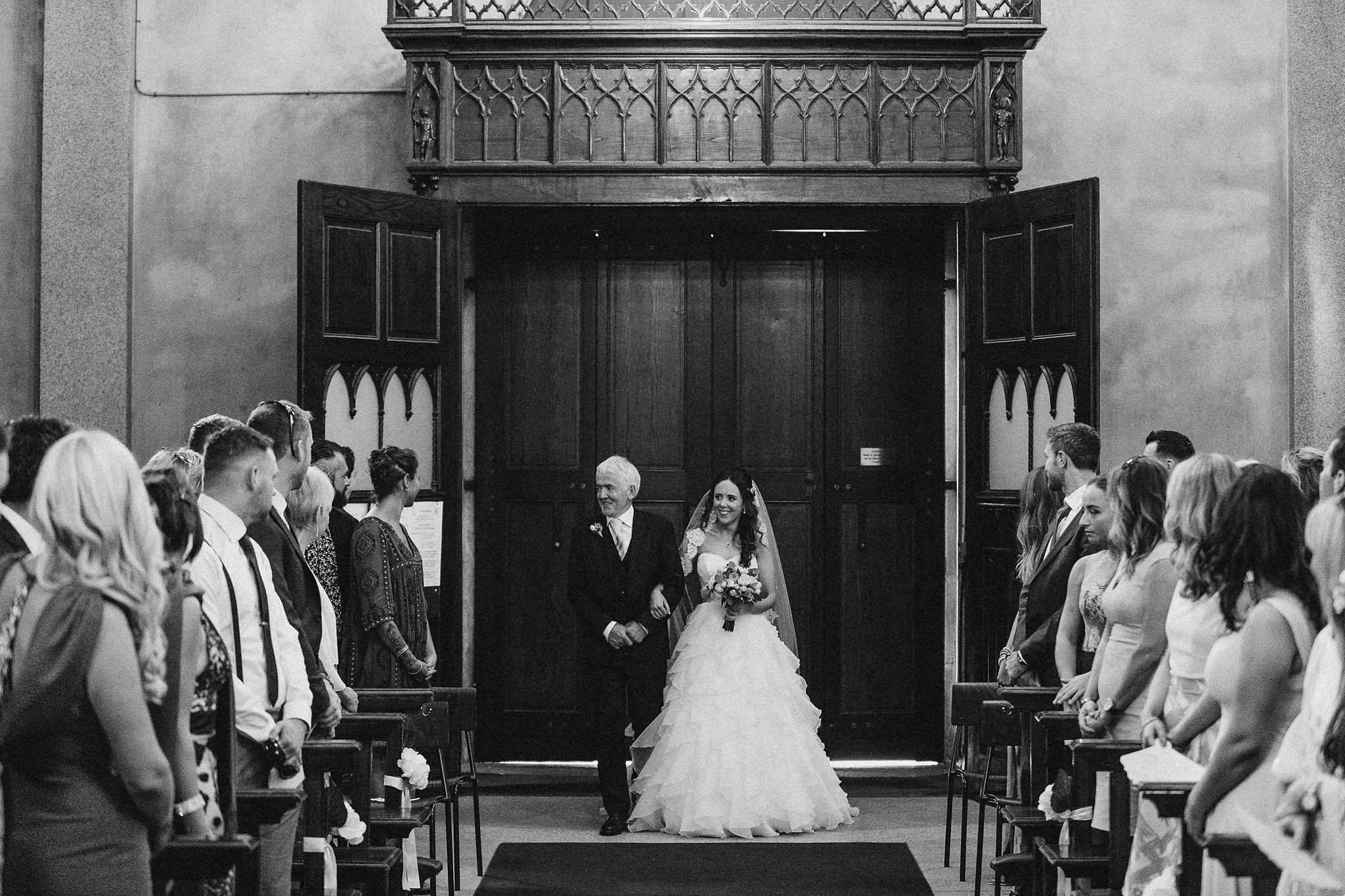 Orla stunned in a Paloma Blanca dress creation. I love this picture of her and her Dad about to take the walk.