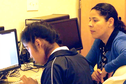 dclc_esther torres_child on computer.png