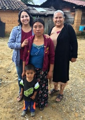 Maria Villa Pablo (left) with a family in Oaxaca