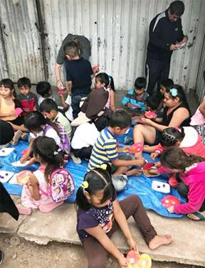 sinaloa_children eating at camp.png
