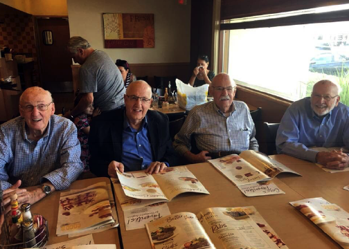 group of men at breakfast.png