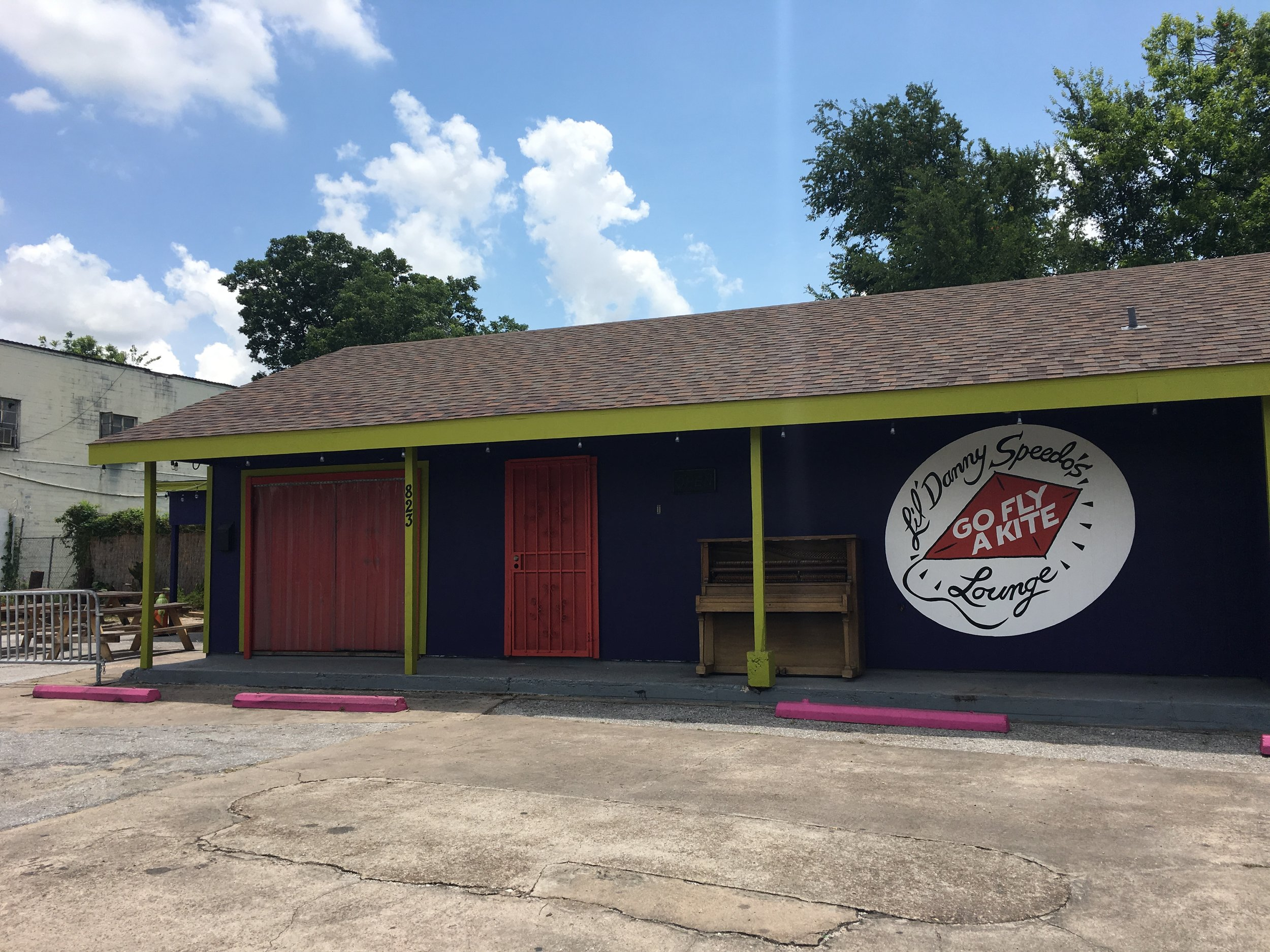 LOCATED AT: 823 Dumble St.   DIVE BAR AND ICE HOUSE WITH POOL TABLES AND OUTDOOR SEATING.