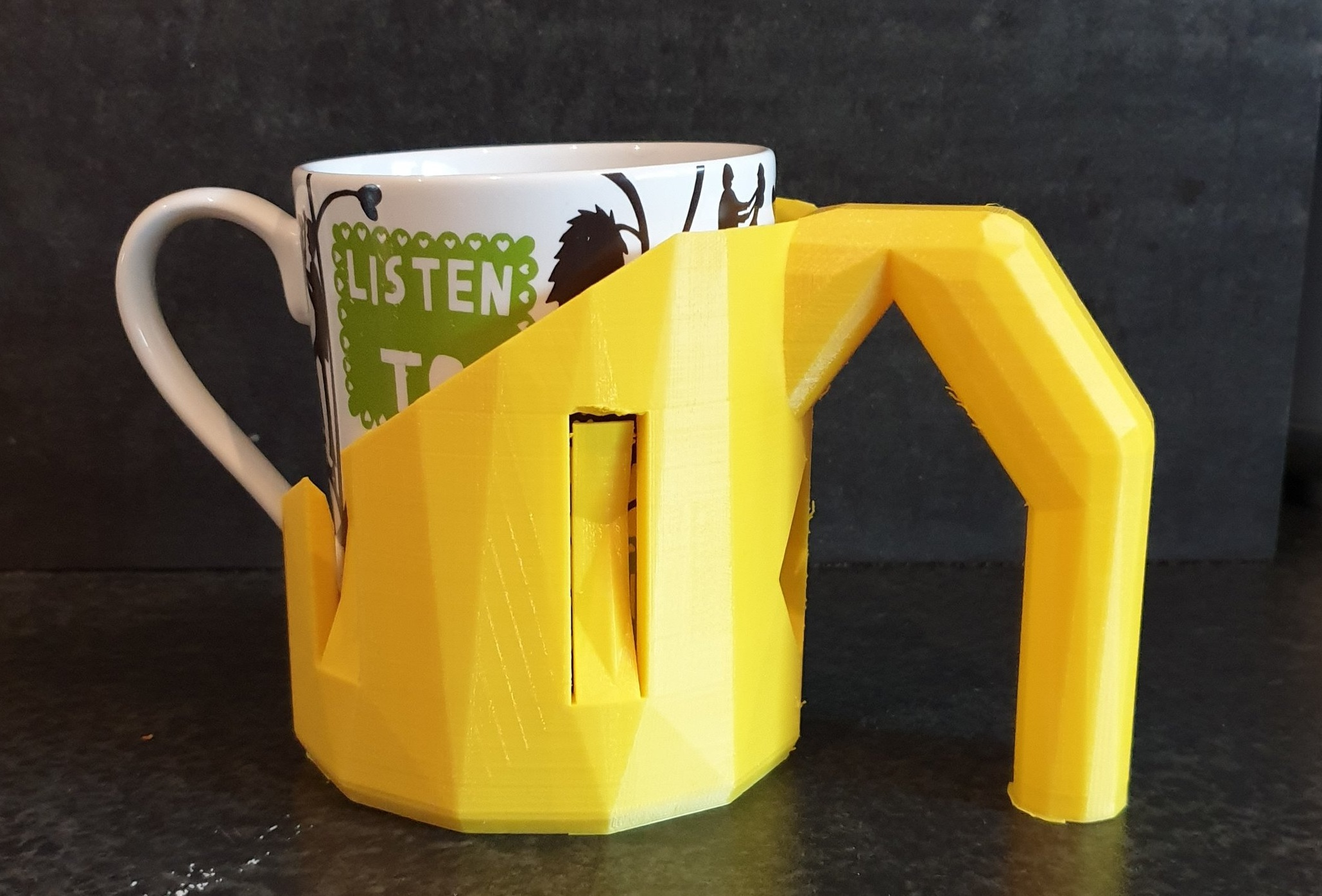 Mug Handle - This handle allows people with decreased fine motor function to continue using their collection of mugs by providing a chunky easy to grasp handle. Printing at a cost of approximately €8 this handle is far cheaper than the commercial equivalent that costs €22. The shared model is for mugs of 79 to 85mm diameter (most common sizes) but can easily be scaled to meet any requirements.