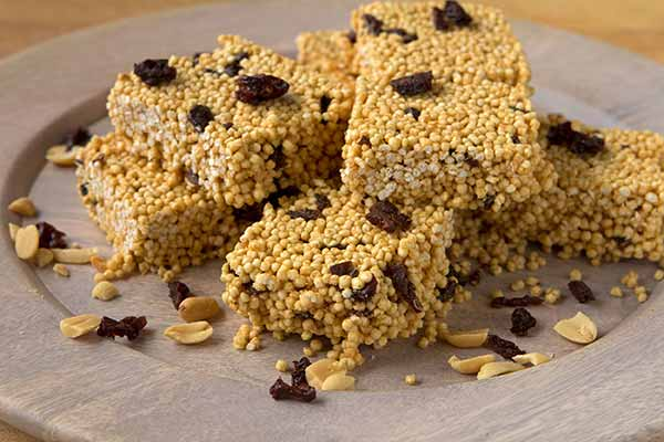 Crispy Quinoa Peanut Butter Treats - These crispy, crunchy, better-than-puffed rice quinoa treats are made with just four ingredients: popped quinoa, creamy peanut butter, honey, and tart, chewy dried cherries. Packed with protein and just a touch of sweetness, they're perfect for an afternoon fuel-up.