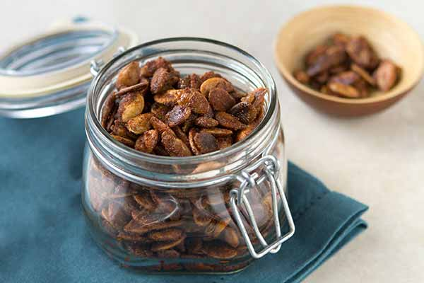 Sweet-Spicy Roasted Pumpkin Seeds - These sweet, spicy, protein-packed nuggets of joy are made with cinnamon, cumin, cayenne, chile powder and a blend of white and brown sugars which helps them carmelize in the crunchiest, most satisfying way. Mix them with dried mango and papaya, roasted almonds and hemp seeds for a delicious trail mix.