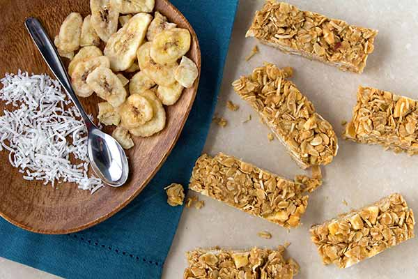 Banana and Peanut Butter Granola Bars - We use peanut butter in these banana-coconut granola bars, but almond or cashew butter would work just as well. Ultra portable and durable, these bars make a great breakfast or on-the-go snack.