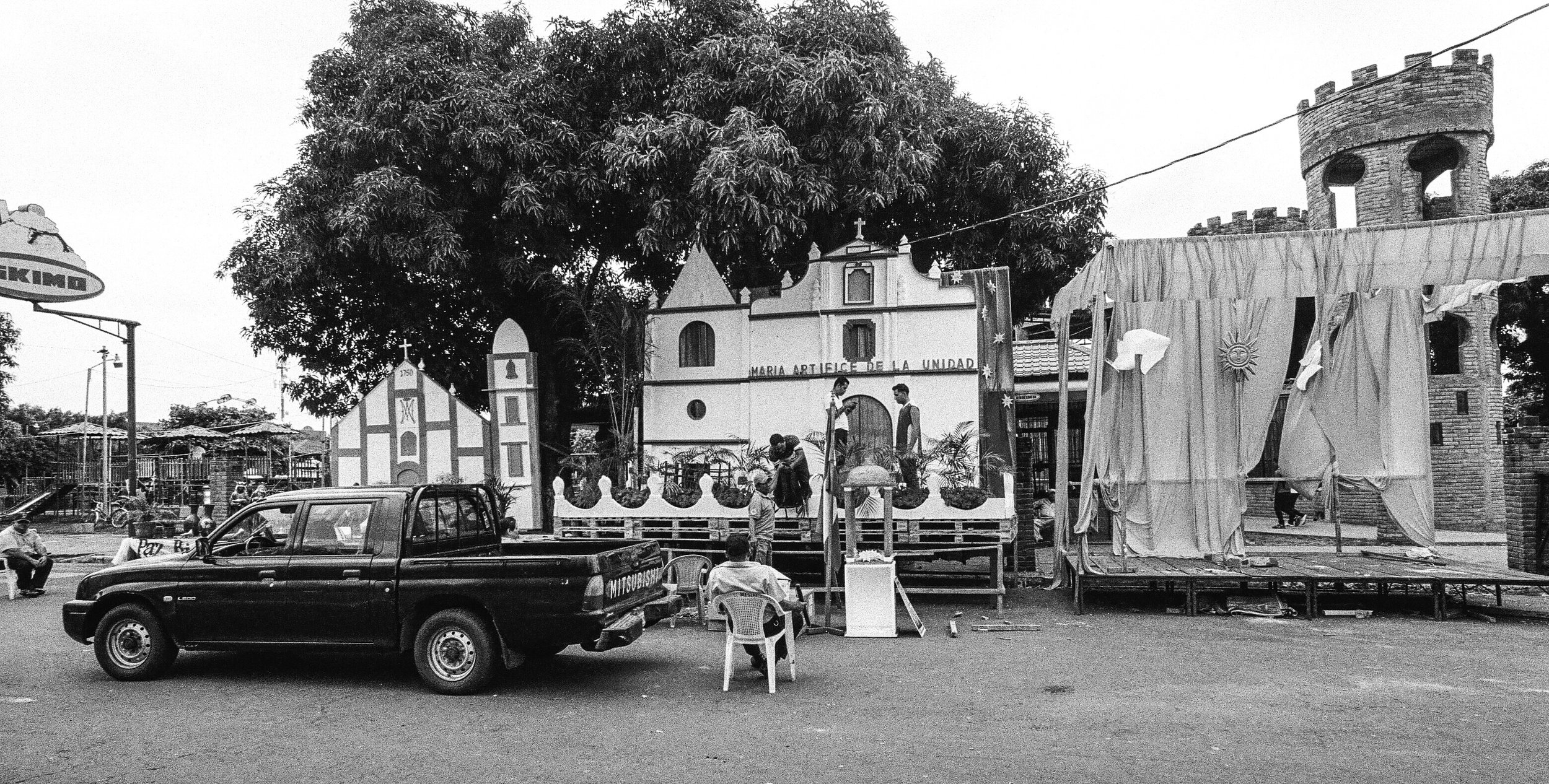 Float being prepared for an upcoming parade, Chinandega plaza. Surprisingly the entire plaza had free wi-fi available. Nikon F2, Ilford HP5+