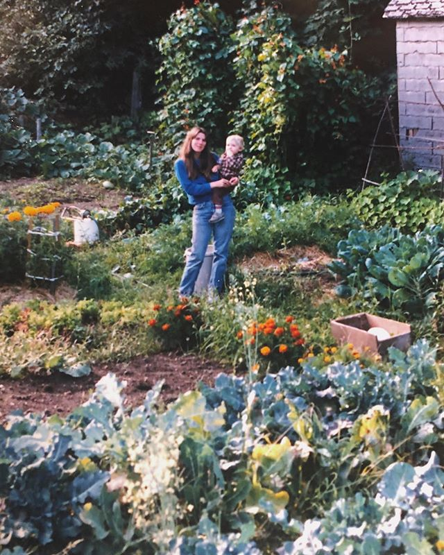 My mama with my brother in her garden. Cougar, Washington 1982.