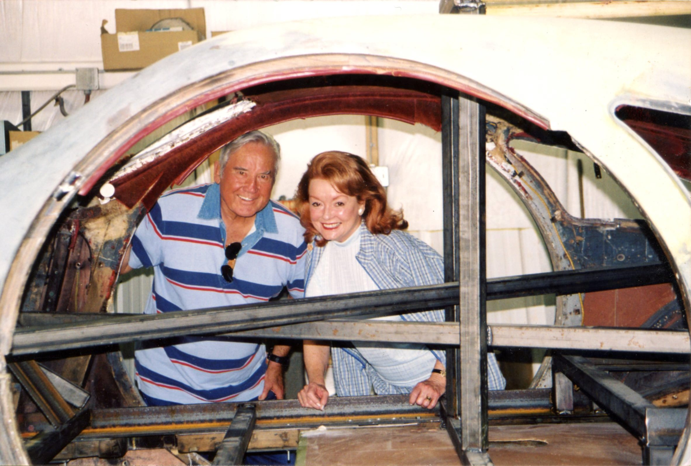 Robert E Petersen and his wife Margie smiling during the restoration of the Round Door Rolls Royce.