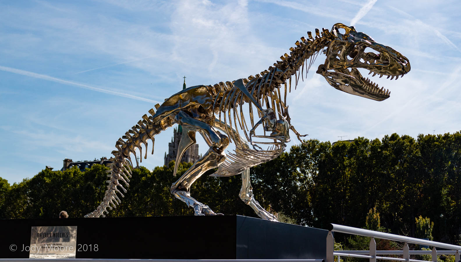 "Philippe Pasqua's chrome ""Tyrannosaurus rex"" (actually a fashioned after a Tarbosaurus) at the Bateaux-Mouches docks on the banks of the River Seine in Paris."