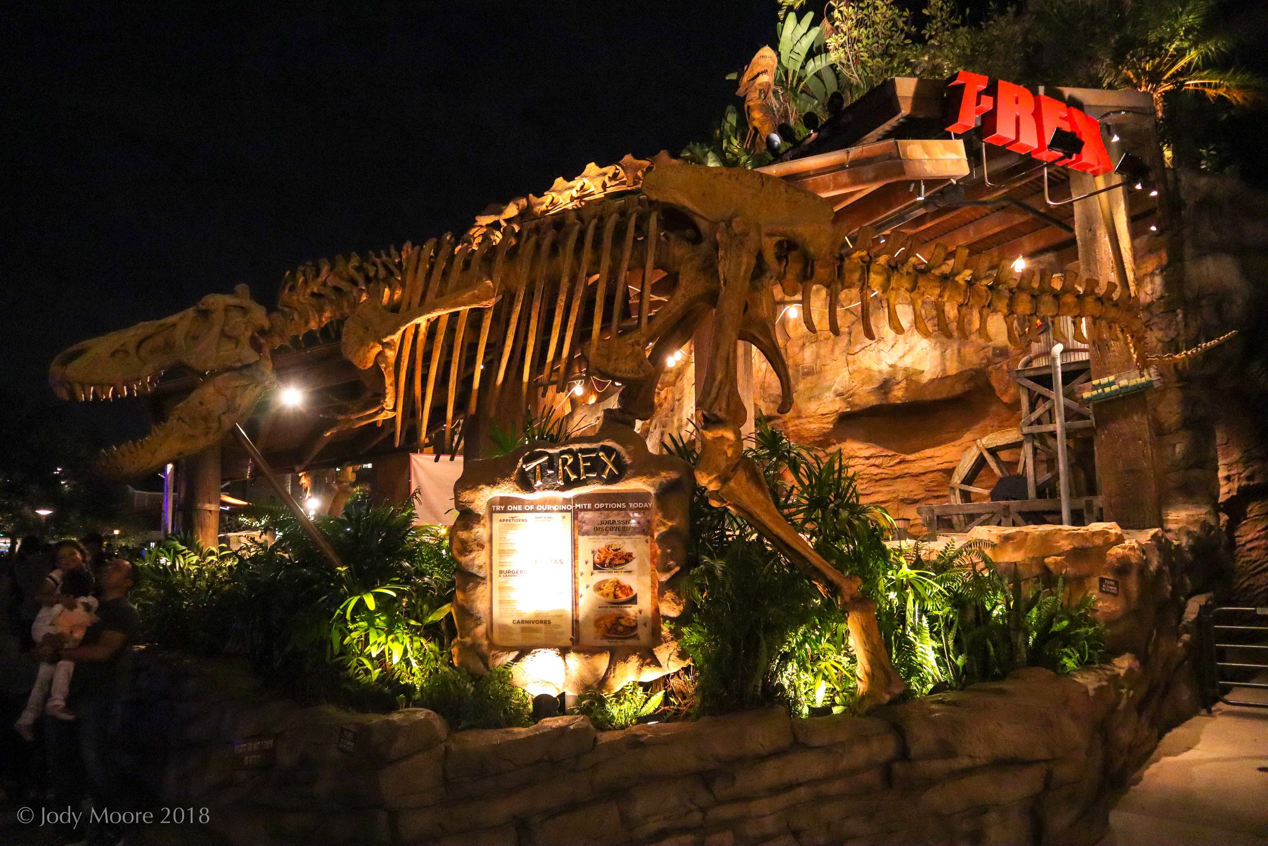 An unknown (and perhaps not specific) T.rex skeleton guards the entrance to the T-Rex Cafe at Disney Springs in Lake Buena Vista, FL.