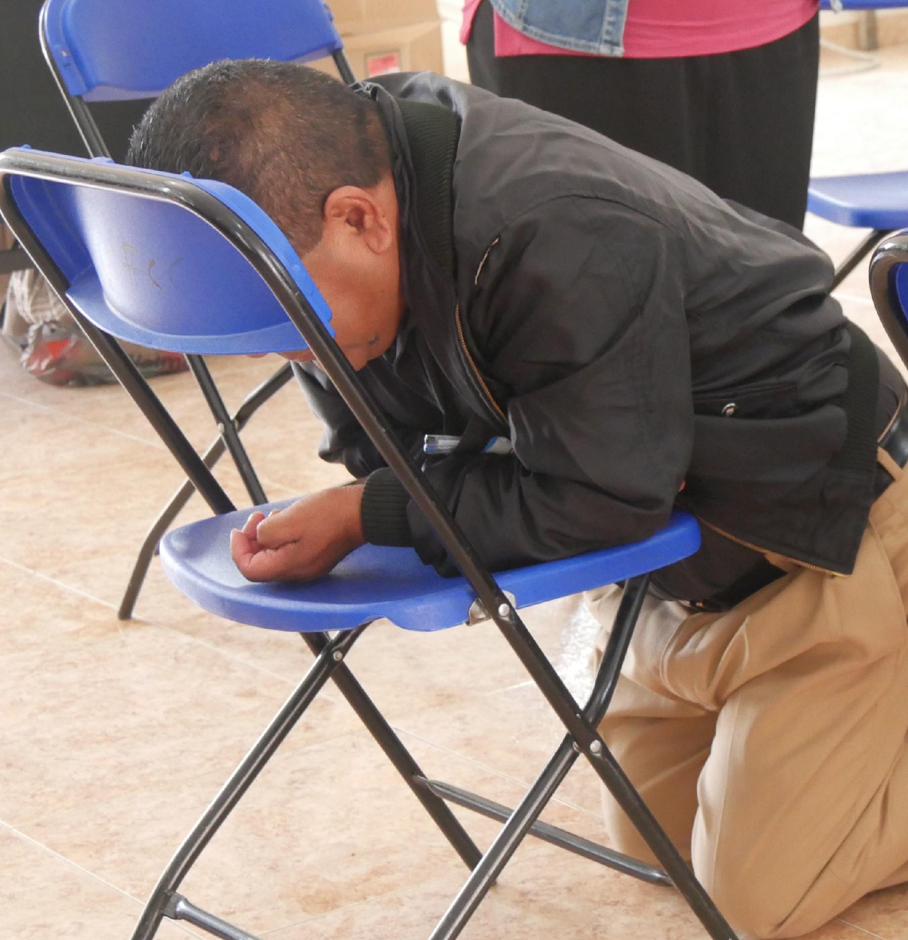 man kneeling praying.jpg