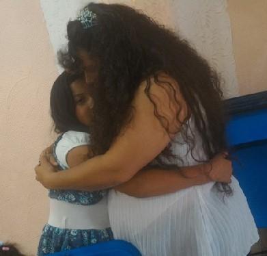 mom and daughter hugging.jpg