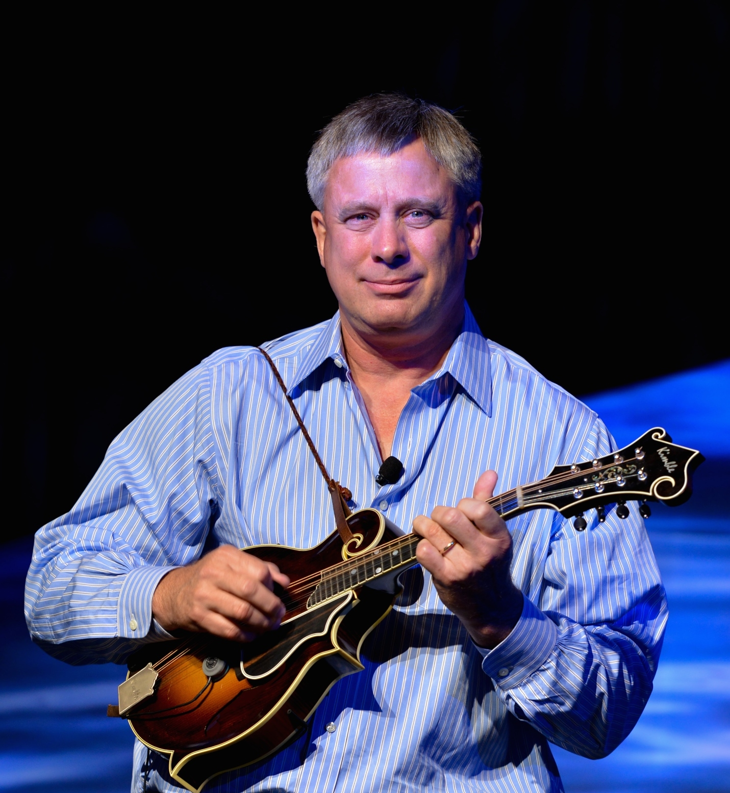 Mark Daly playing mandolin at the Breakers