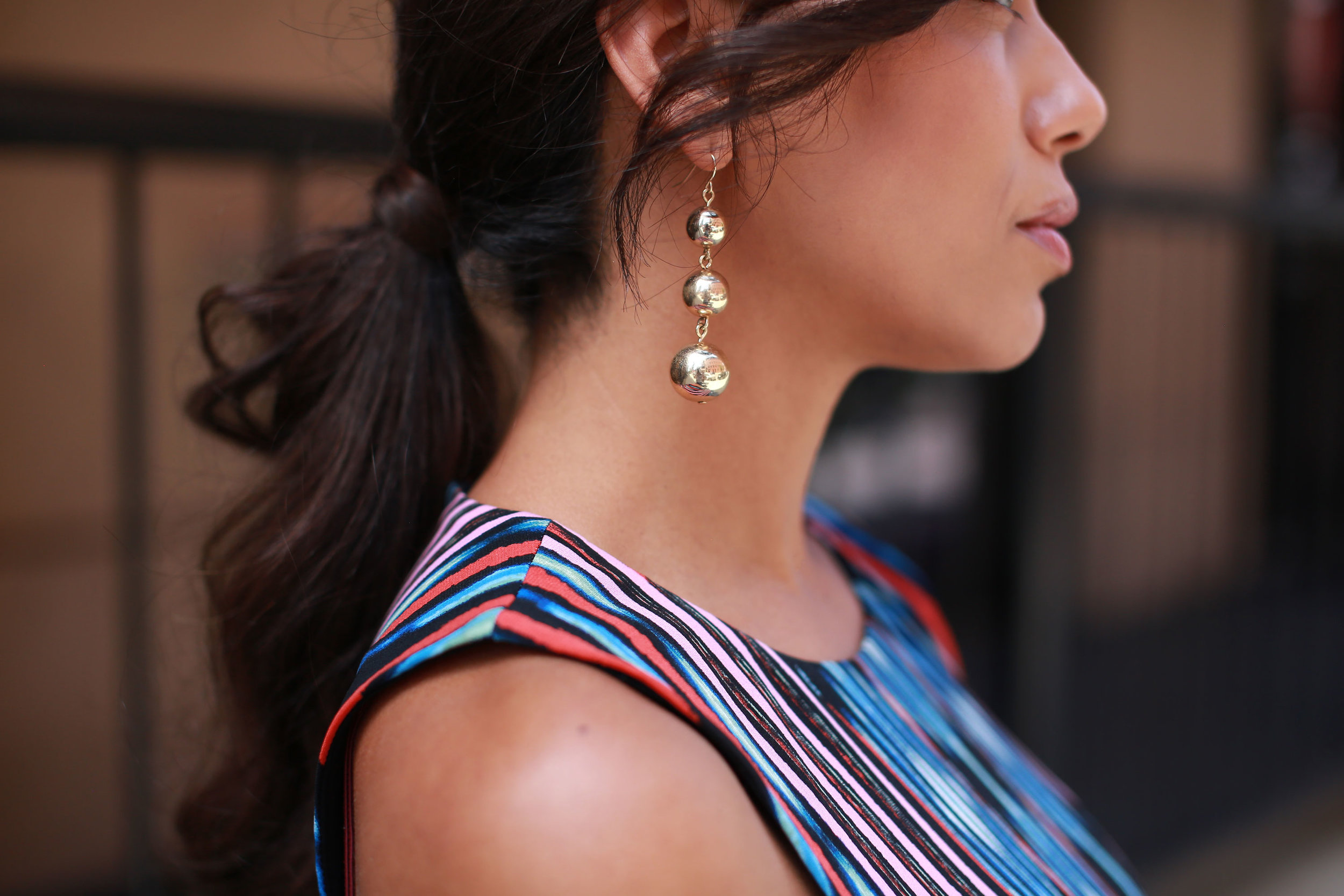 THE EARRINGS - Time to have some fun! Bring some attention to your stunning smile with a pair of fun statement earrings, like these layered gold baubles!