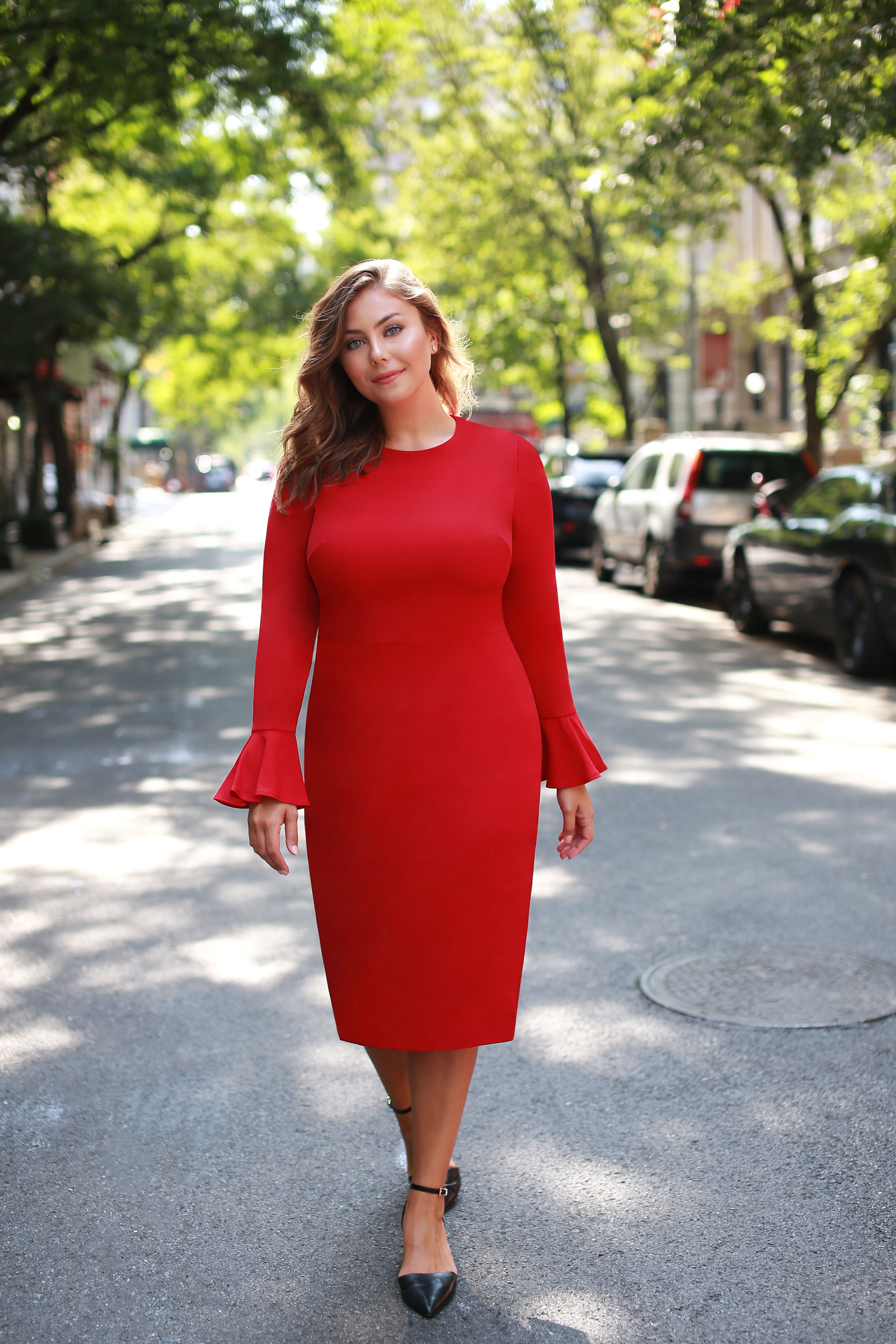 5. Office Occasion - The solution when you're looking for a timeless- but not boring- cut. This deep, apple red tone and ruffle sleeve details draws attention in all the right (professionally appropriate) ways and will sure to be a party favorite.