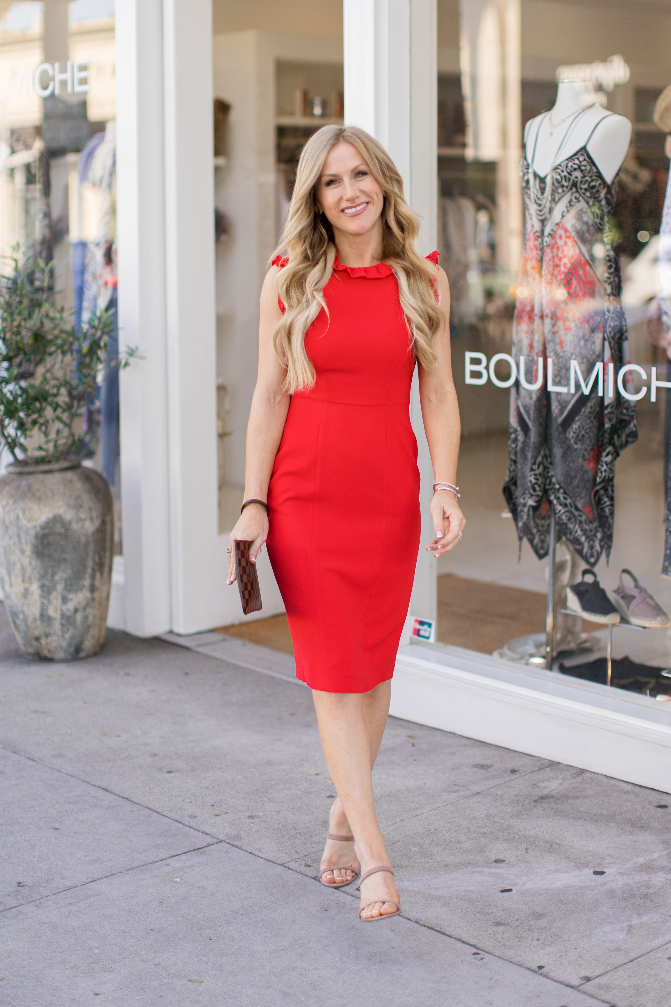 Meredith is wearing our  Charlene Midi , also available in  petite  sizes.