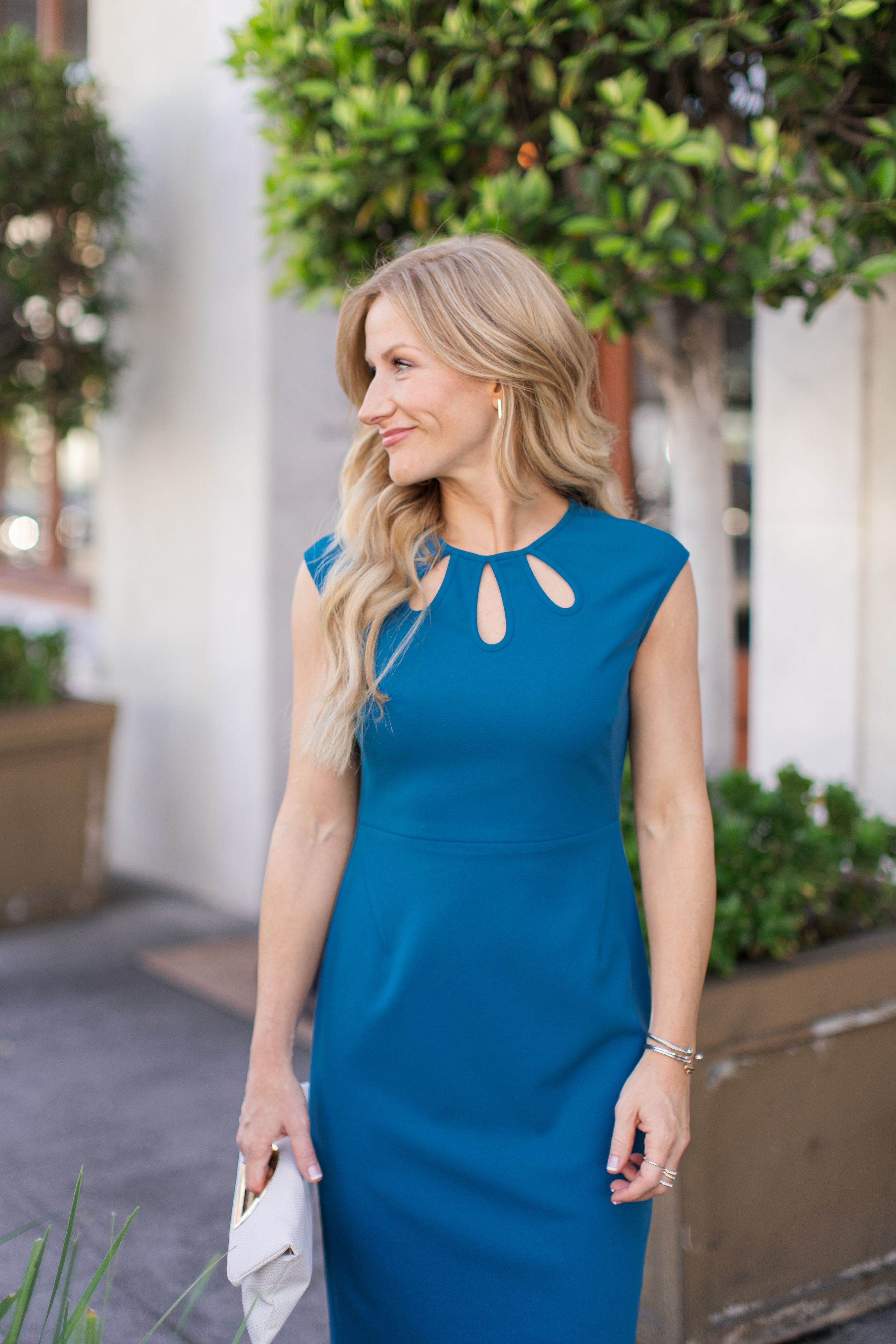 Meredith is wearing our  Alyssa Midi , also available in  petite  sizes.