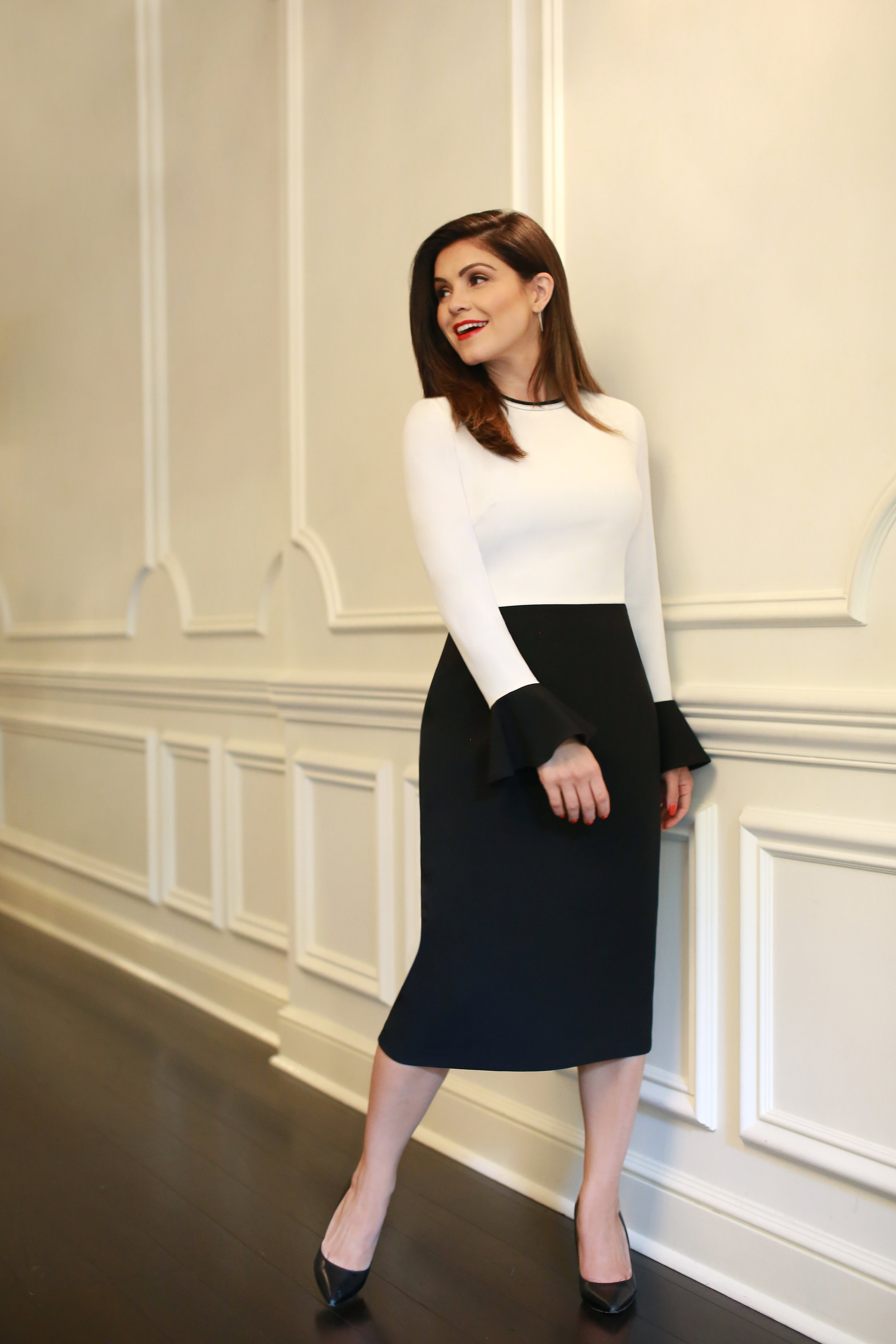 The Sullivan - We all know color-blocking is here to stay, which is why we made it our mission to create the easy, versatile need-it piece of your neutral dressing dreams.Black and white blocking between top, skirt, and flare sleeve flirts with the illusion of a two-piece, but don't be fooled! This is 100% one-piece ease.