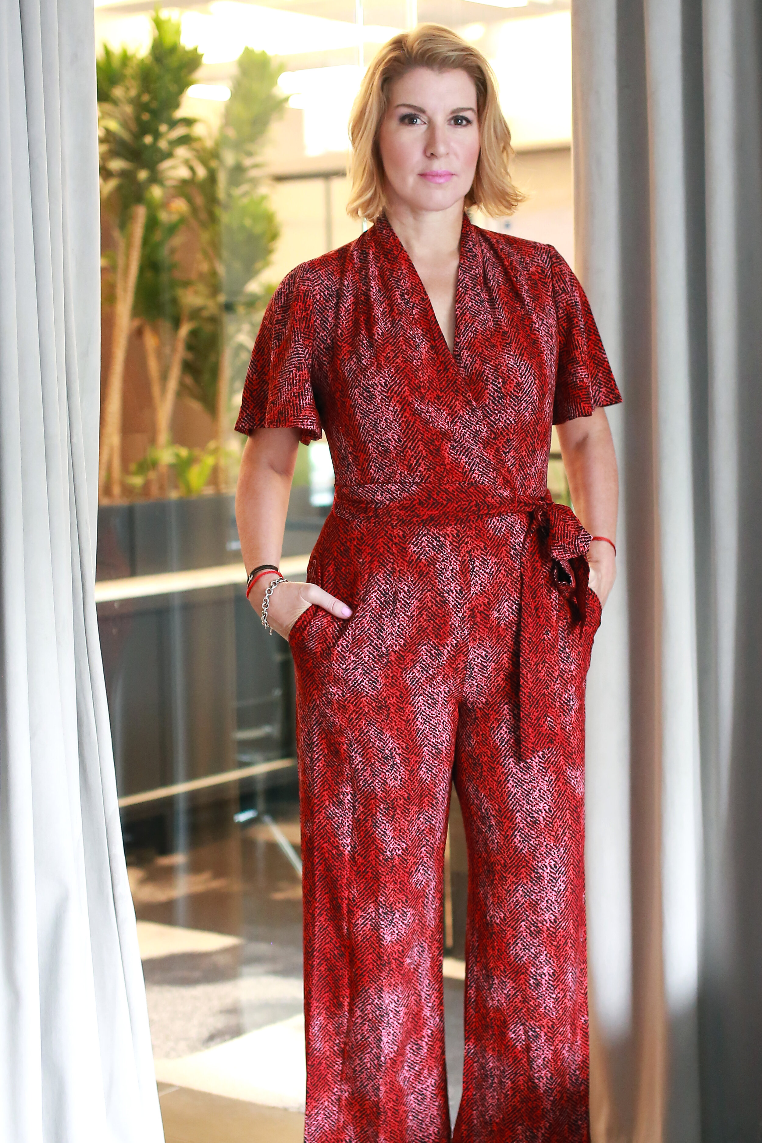 """""""I wanted to tell stories in a more personal way."""" - Sandy is wearing our Dot jumpsuit."""