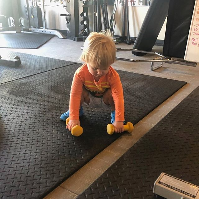 Baby Brooks is practicing his weight lifting to be like his mommy! #SOCute #Workout32789 #WeightLifting #FamilyWorkout