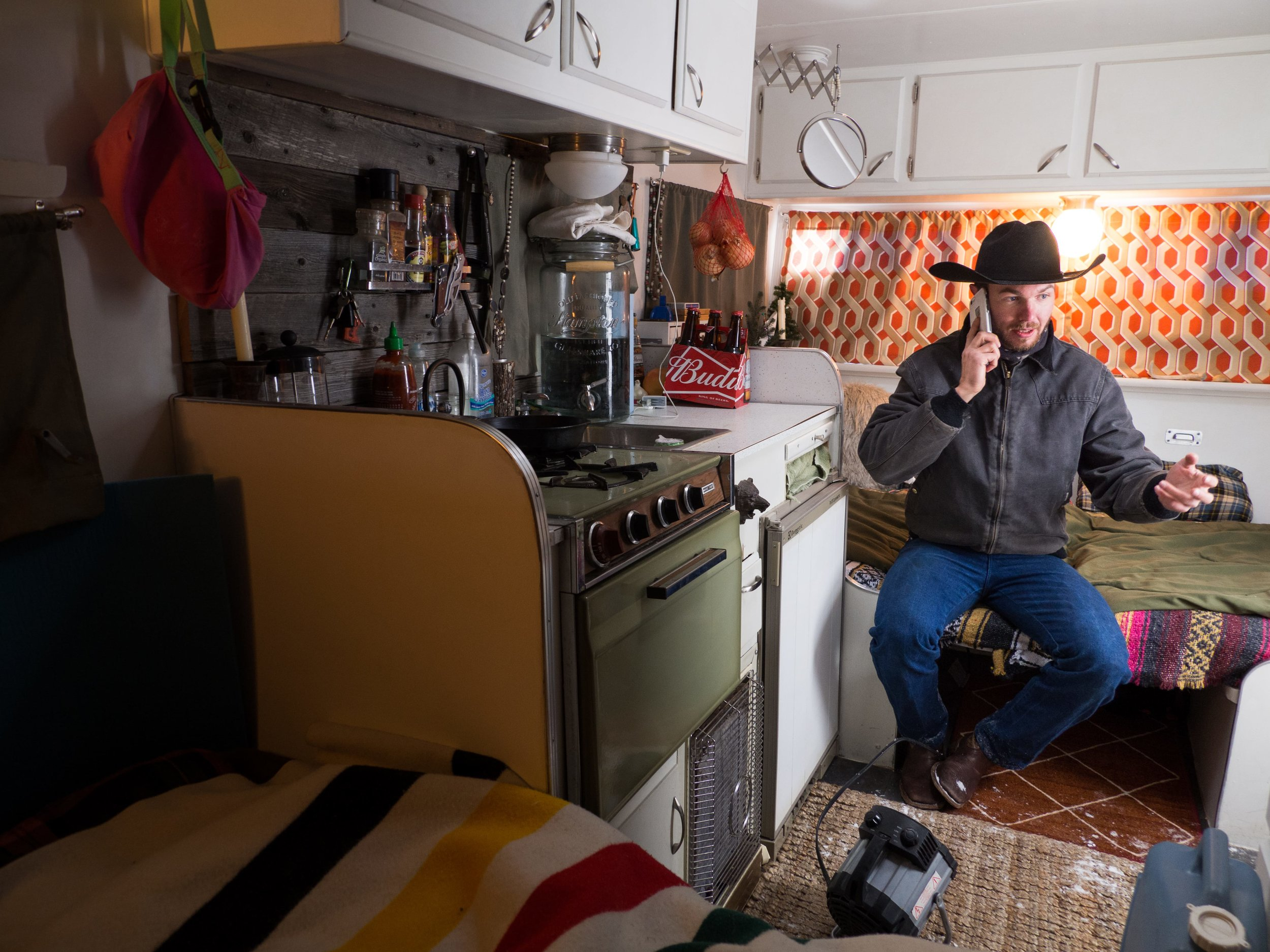 Corey owns a $400k condo in Big Sky, Montana, the state's most prestigious ski town, and manages 6 other rental properties. To make ends meet and grow his business he lives in a trailer during the winter outside of town. Shot on Olympus E-M1 Mark II, M.Zuiko 9-18mm.