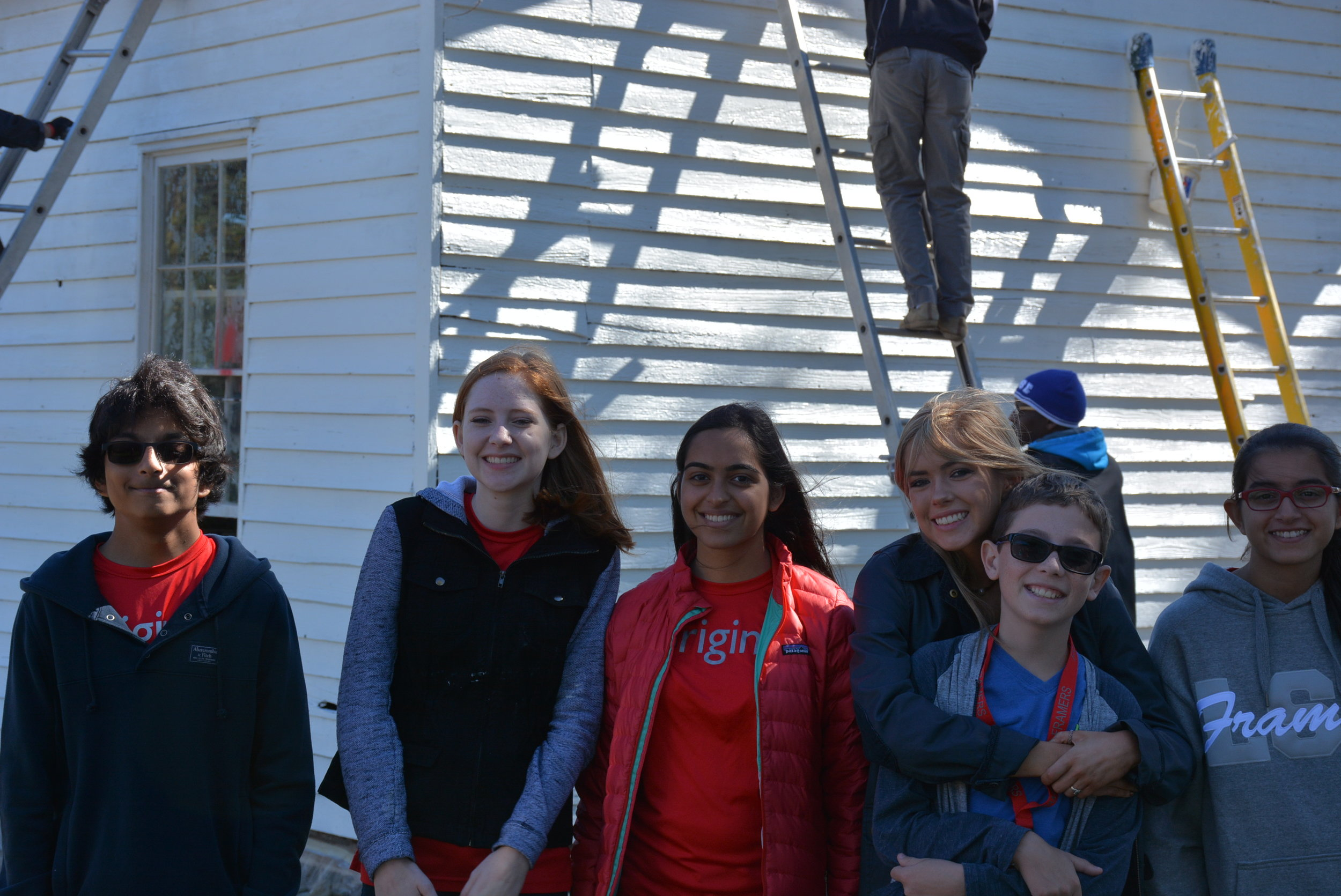 Members of the Ashburn Colored School rehabilitation team celebrate after the removal of the graffiti (left to right: Kamran, Katie, Shailee, Gwyneth, Taz, and Ella).
