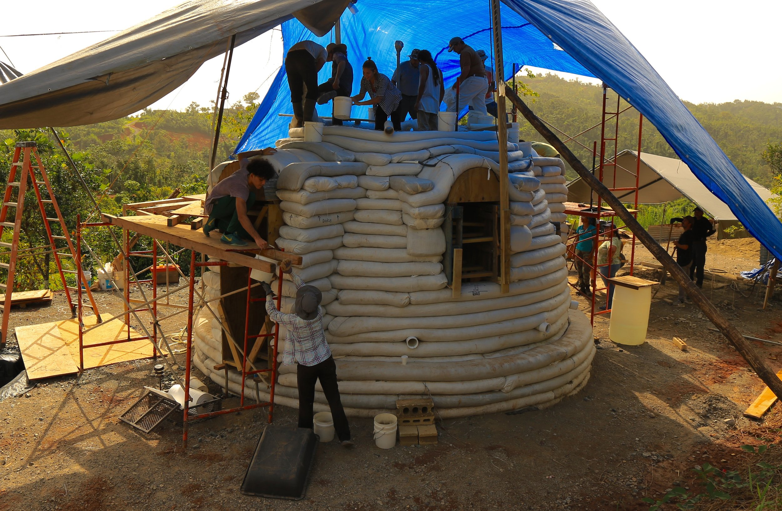 Superadobe in Puerto Rico - CalEarth | OCTOBER 15, 2018CalEarth alum Owen Ingley took a workshop in 2009 and has been working to promote SuperAdobe in Puerto Rico for the last 8 years. His nonprofit, Plentitud PR, has completed the construction of 3 structures in Puerto Rico, and all of them successfully survived the devastating impact of Hurricane María one year ago. In February 2018 Plenitud PR was granted funding from the Hispanic Federation to teach workshops on Superadobe emergency shelters and build a demonstration house. The work was recently featured on the front page newspaper article in the local newspaper, and they are receiving a lot of interest from local government officials. Keep up the great work Owen! (View)
