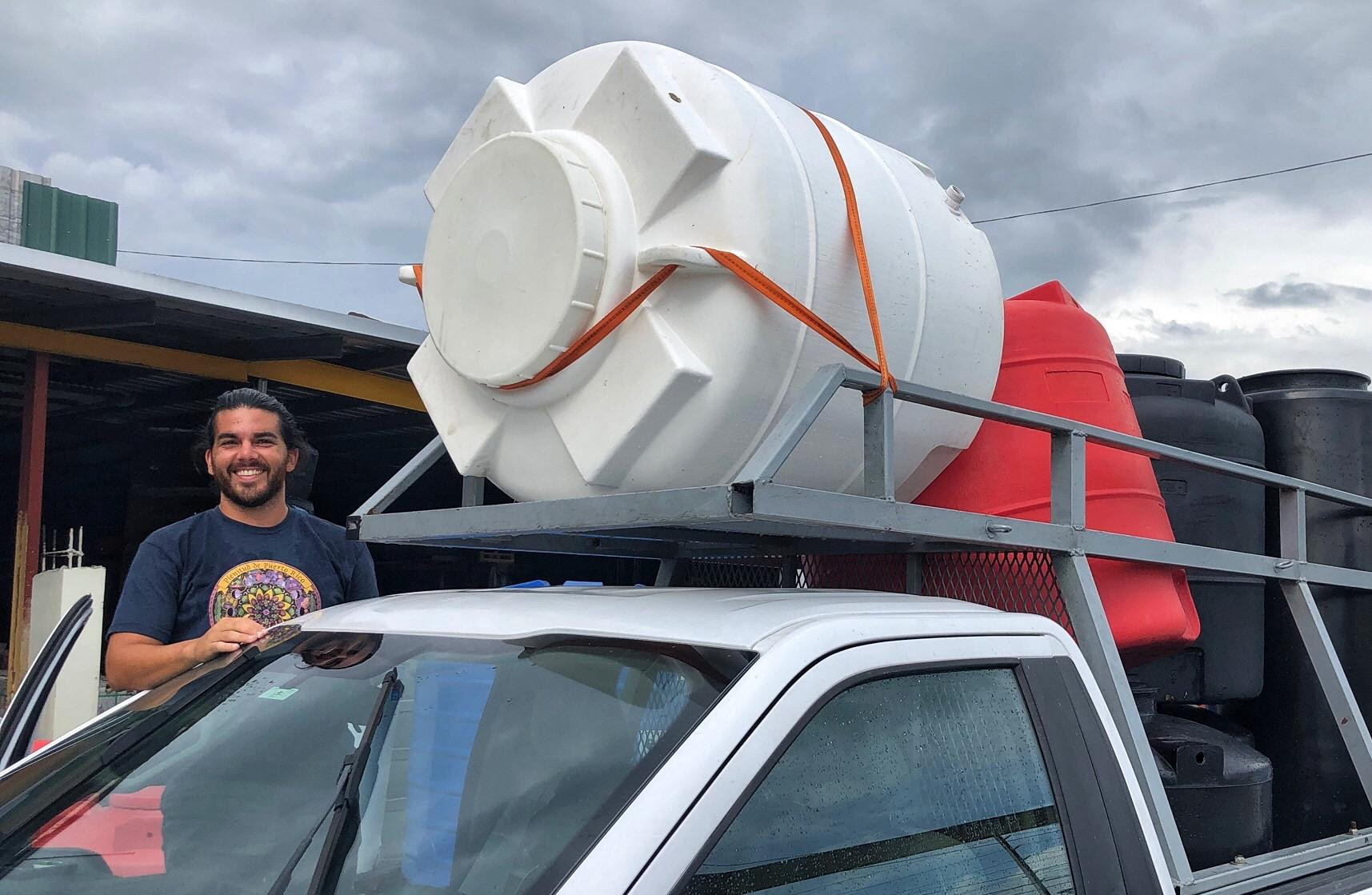 Raymond Balaguer transports the cisterns for the installation of rainwater collection systems in homes of Las Marías, as part of the Rainwater Harvesting Mentorship Program.