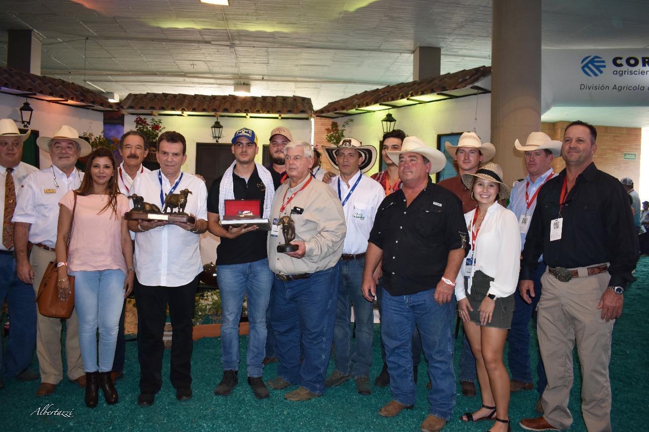 J.D. Hudgins Group presenting the trophy to Jamie Moroso for being named outstanding exhibitor and showing the World Congress Champion Female.
