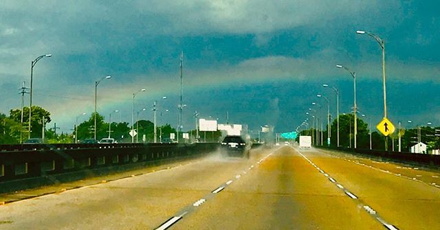 A NOLA rainbow from a moving car.