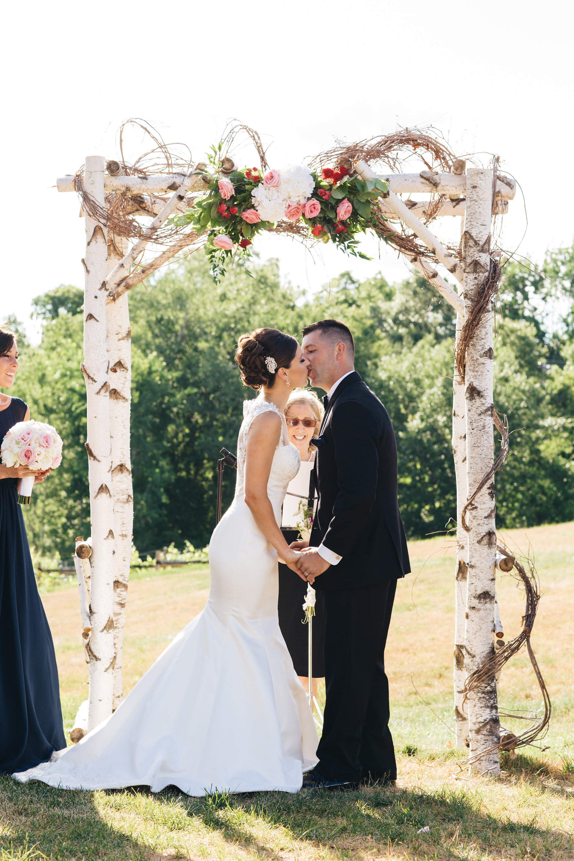 """""""Judy made our wedding day so special! My husband and I knew she would be the perfect fit as soon as we met her. She was so sweet and had a lot of ceremony options so we were able to pick the one that fit us best!""""— Kaitlin and Jay -"""