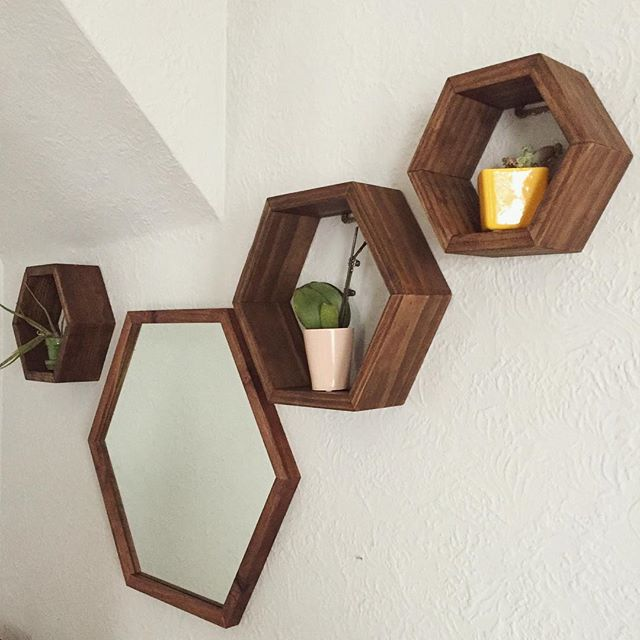 Once again, rearranging our forever changing dining room wall decor. Today it is our set of 3 hexagon shelves paired with our large walnut wood framed hexagon mirror.