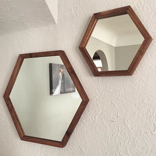 Spending the day making walnut wood framed hexagon mirrors